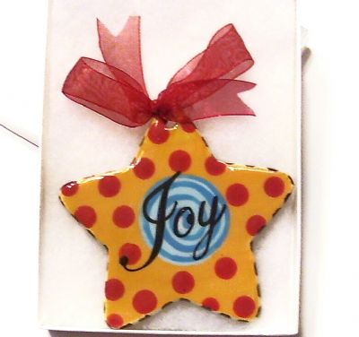 2). Yellow red and blue star ornamen Item: CC3302