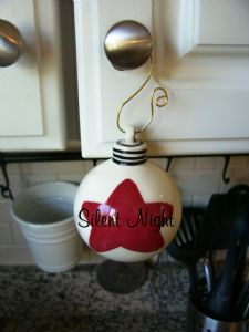 15). Hand Painted ceramic ball ornament Item: #CC12009star